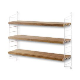 String Pocket shelving system in oak